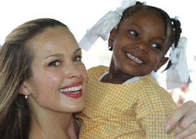 Happy Hearts Fund founder and chairwoman, Petra Nemcova with a happy new student in Haiti.    (PRNewsFoto/Happy Hearts Fund)