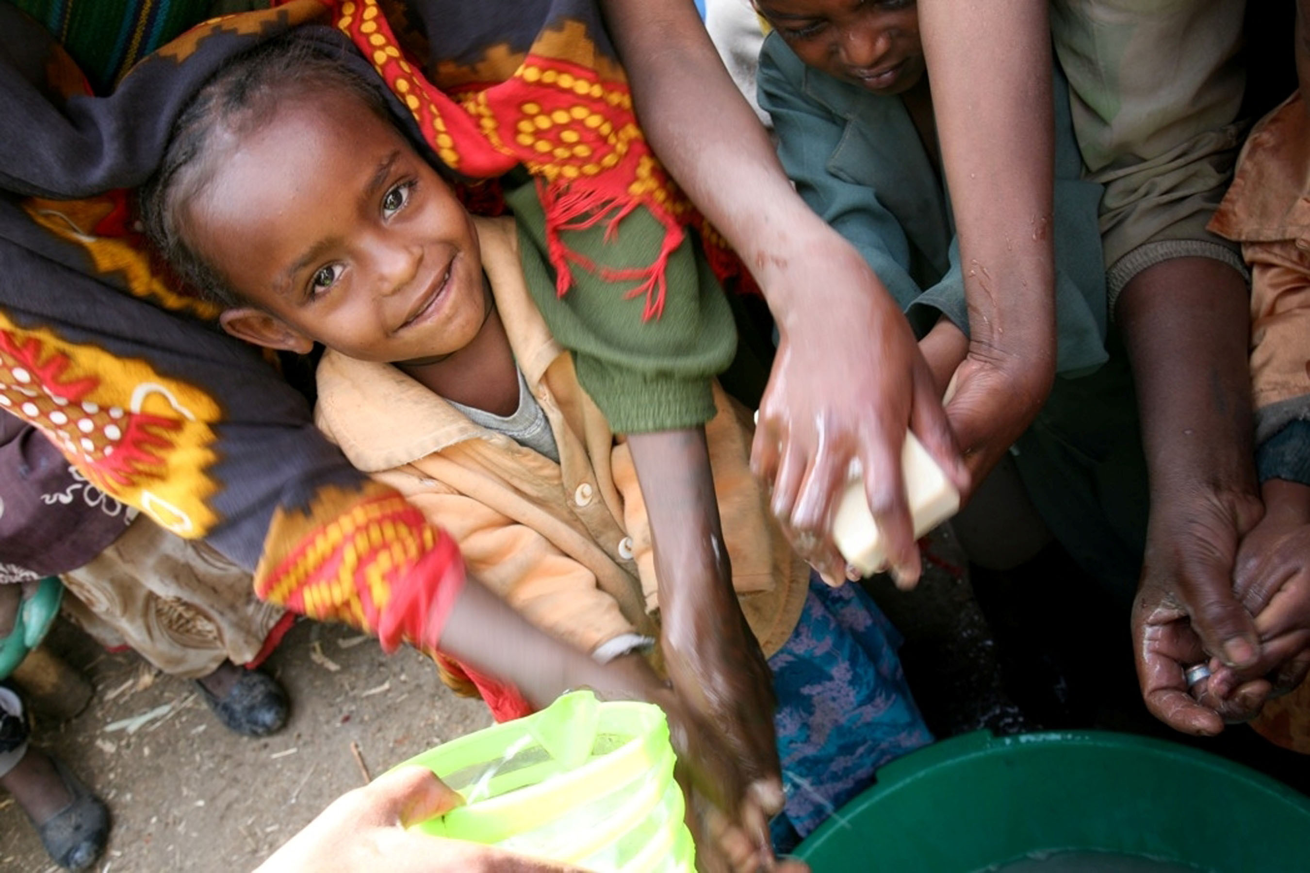 Ethiopian children receiving soap through Clean the World earlier this year (Source: World Vision).  (PRNewsFoto/The Harrah's Foundation)