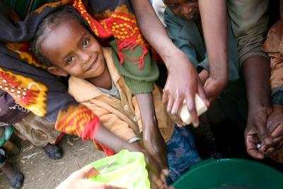 Ethiopian children receiving soap through Clean the World earlier this year (Source: World Vision).  (PRNewsFoto/The Harrah's Foundation)