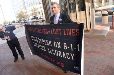 Jamie Barnett, Director of the Find Me 911 Coalition, Holds Banner Urging FCC To Address Wireless 9-1-1 Crisis.  (PRNewsFoto/Find Me 911 Coalition)