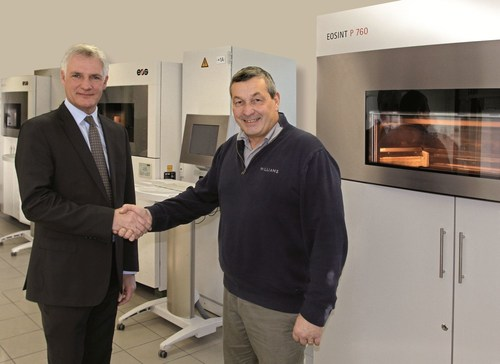 (f.l.t.r.) Stuart Jackson, Regional Manager EOS UK with Richard Brady, Advanced Digital Manufacturing Leader, in front of an EOSINT P 760 system (Source: EOS) (PRNewsFoto/EOS) (PRNewsFoto/EOS)