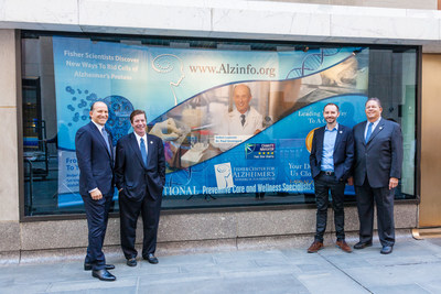Mr. Howard Lutnick, Vice Chairman of the Fisher Center, Mr. Kent Karosen, President and CEO of Fisher Center, Dr. Marc Flajolet, Assistant Research Professor at the Fisher Center for Alzheimer's Research at The Rockefeller University and Mr. Murray Rubin, Secretary of Fisher Center Unveil Window Display at Rockefeller Center Plaza Featured Throughout Alzheimer's Awareness Month