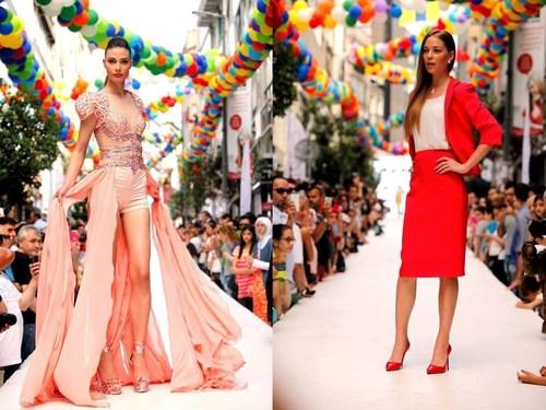 Glamorous street fashion models walking the runway during the 'Osmanbey Weekend' street fashion show ...