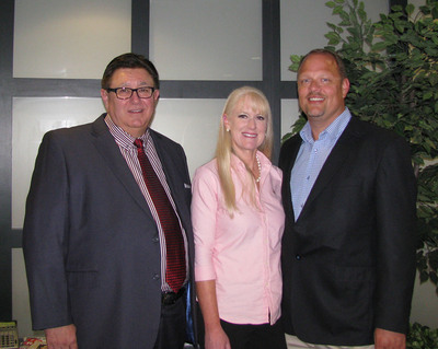 Pictured left to right:  Thomas A. Sacco, President and CEO of Homestyle Dining, LLC, Heather L. Hopkins and Tim Hopkins, Owners of HLT Foods, LLC.  (PRNewsFoto/Homestyle Dining LLC)