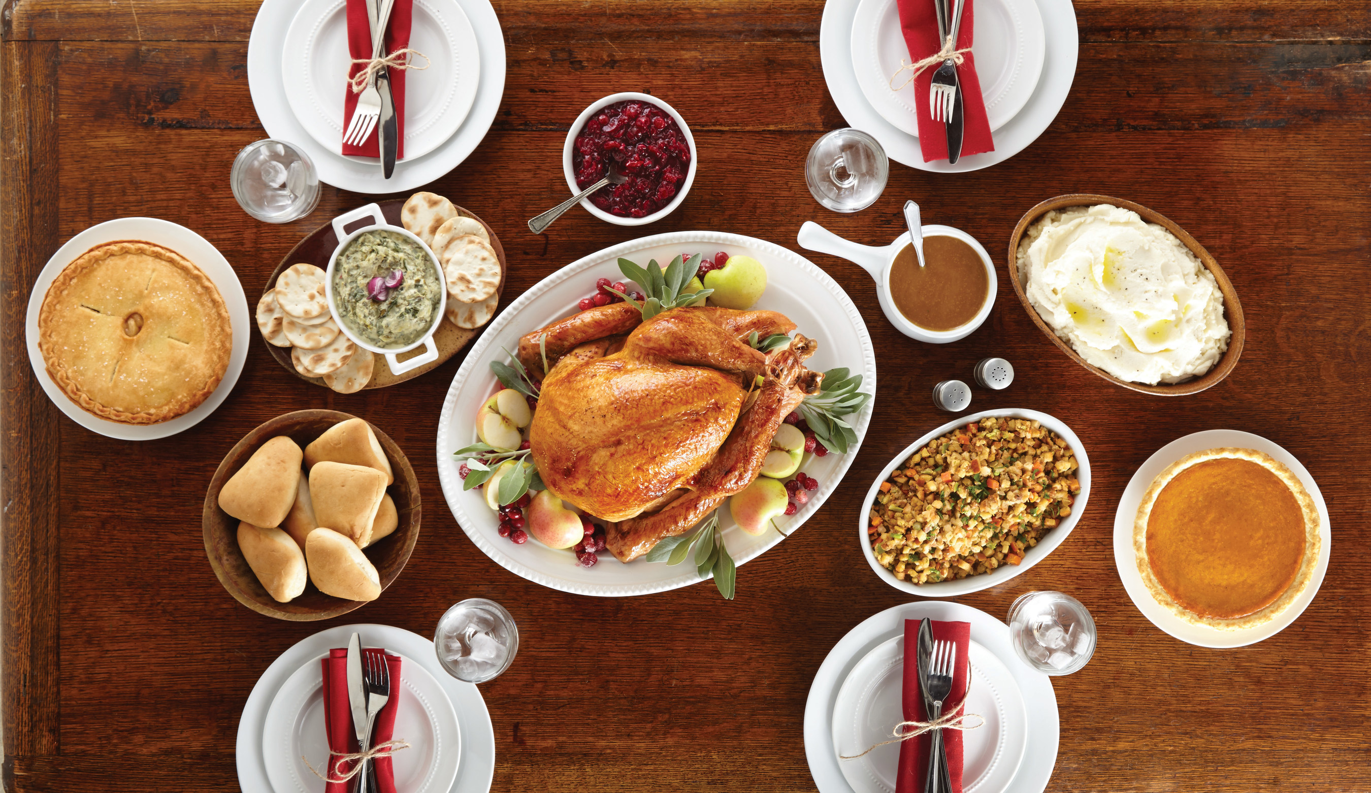 Boston Market Heat & Serve Thanksgiving Meals can feed four to 12 guests. A Thanksgiving meal for 12 includes turkey, mashed potatoes and gravy, cranberry walnut relish, vegetable stuffing, rolls, an appetizer and pies for $9.17 per person.