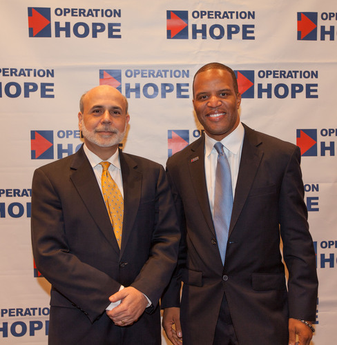 Operation HOPE Founder, President and CEO, John Hope Bryant welcomes Federal Reserve Chairman Ben Bernanke to the Operation HOPE Global Financial Dignity Summit in Atlanta on November 15, 2012.  (PRNewsFoto/Operation HOPE)