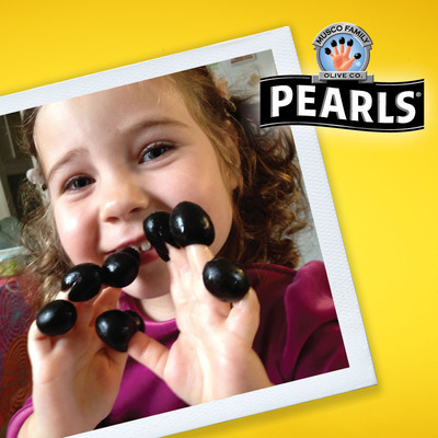 A Pearls 'Fun at Your Fingertips' contest entrant shows off her olive fingers. Submit your own olive fingers at Facebook/Pearls Olives.  (PRNewsFoto/Musco Family Olive Co.)