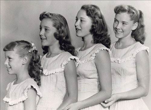 The Lennon Sisters in 1955 (l-r) Janet (age 9), Kathy (age 12), Peggy (age 14) and Dianne (age 16). Dubbed America's Sweethearts of Song by the American public, the famous singing sisters performed on the Lawrence Welk Show for 13 years, and went on to record breaking performances in every major city in the U.S.  The Lennon Sisters, still wowing audiences today, will be celebrating their 55th Anniversary this Christmas Eve 2010.  (PRNewsFoto/KatJan)
