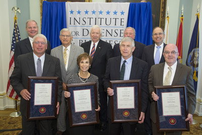 Front row: New IDB Executive Fellows holding their certificates at the Induction Ceremony at the Army and Navy Club on Sept. 17, 2014. Vice Admiral John P. Currier, USCG (Ret.), Major General Kathleen D. Close, USAF (Ret.), General Benjamin S. Griffin, USA (Ret.) and Admiral John C. Harvey, Jr., USN (Ret.); Back row: IDB Board of Directors - MG Jim Hodge, USA (Ret.), Former Governor of North Carolina, James G. Martin, Mr. Thomas Bradshaw, Jr., Mr. Roger Perry, Sr. and Mr. Mark Cramer (PRNewsFoto/Institute for Defense and Bus...)
