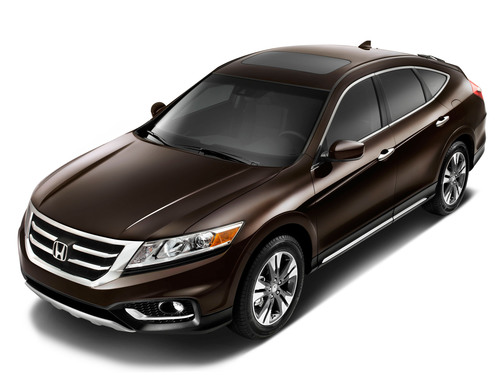 Receiving extensive updates, the 2013 Honda Crosstour introduces more purposeful exterior styling, significant upgrades to the interior design and materials, and a more powerful, fuel-efficient Earth Dreams(TM) V-6 engine coupled to a six-speed automatic transmission with paddle-shift control. The rugged new styling, teamed with class-leading fuel-efficiency and a lower MSRP on the base four-cylinder model make the 2013 Honda Crosstour the smartest choice in a premium mid-size crossover.  (PRNewsFoto/American Honda Motor Co., Inc.)