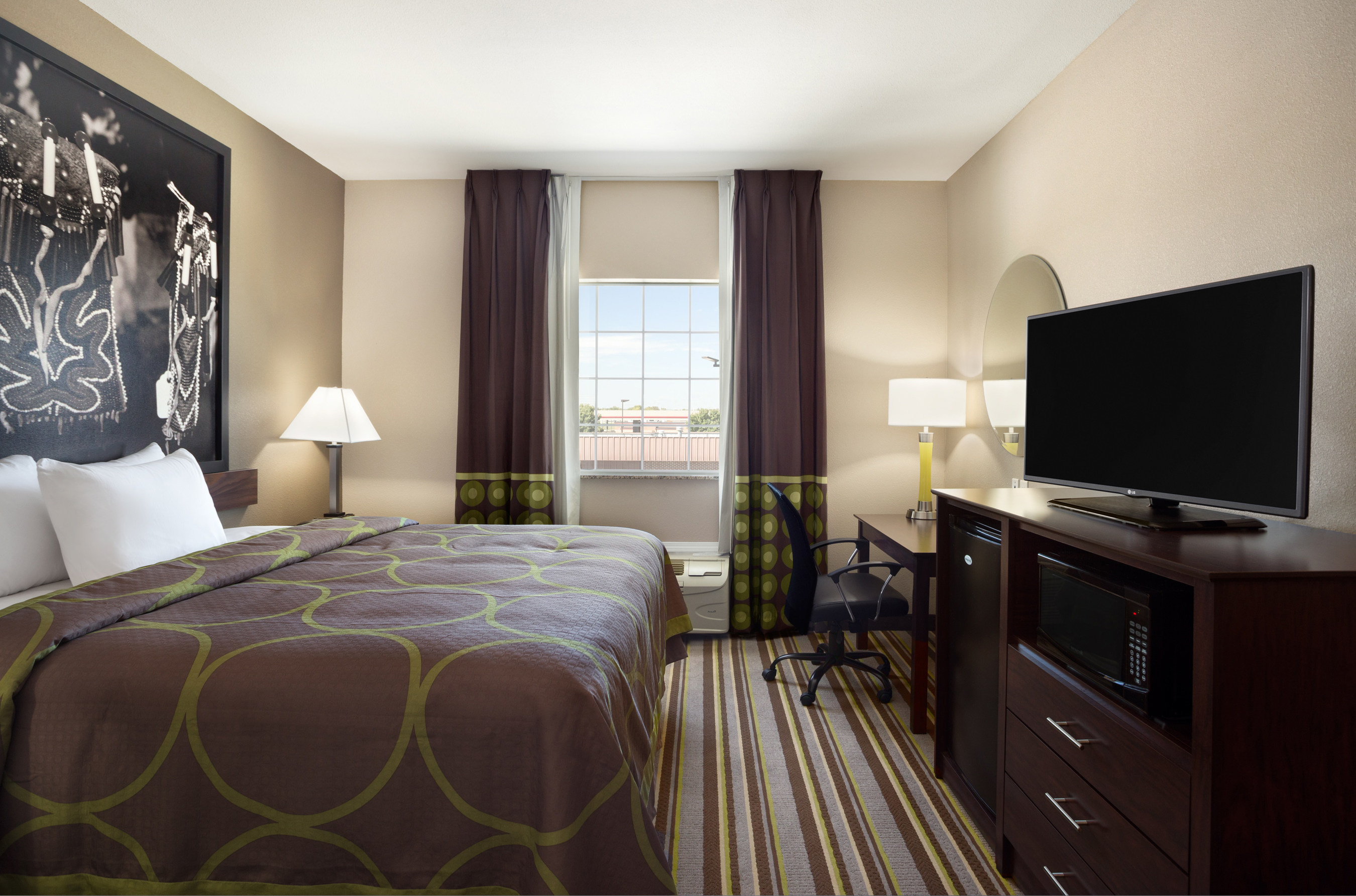 The Super 8 brand's North American redesign centers around a reimagined guestroom featuring soothing color palettes, sleek finishings and bedding, as well as modern amenities and local artwork. Above, the Super 8 in Owasso, Okla.
