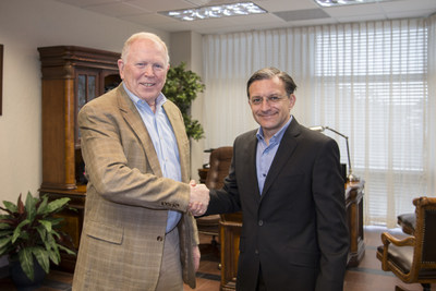 ADU's President, Dr. David Greenlaw and Pearson Online Learning Services COO, Todd Hitchcock shake hands as they renew their partnership.