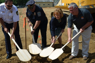 Rustic Crust and American Flatbread frozen pizza CEO Brad Sterl (right) was joined by New Hampshire Governor Maggie Hassan (second from right), New Hampshire Police, Fire & EMS Foundation Founder and President Jim Valiquet (second from left) and Pittsfield, NH Fire Chief Robert Martin (left).