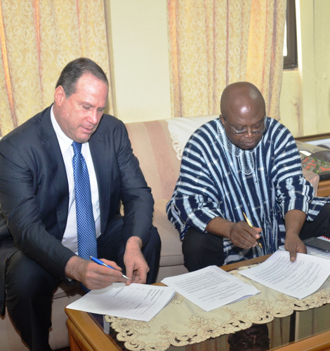 Ghana Agriculture Minister Humado executing MOU with Blumberg Grain Chairman and CEO, Philip Blumberg.  ...