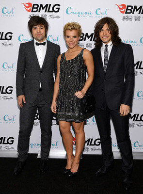 The Band Perry, who collaborated with Origami Owl to create a limited-edition Pioneer Tag, stops by the Big Machine Label Group's CMA Awards After Party, co-sponsored by Origami Owl, to show their support on November 6, 2013.  (PRNewsFoto/Origami Owl)