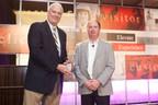 James Busam, Gilbane Vice President, National Client Team accepts JLL Supplier Distinction Award from Denver Clark, Jones Lang LaSalle CPO for the Americas