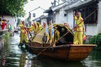 Dragon boat rowers on the waterways in Zhouzhuang; Dragon Boat rowing is an ancient ritual and a vital piece of Chinese heritage that Zhouzhuang is seeking to preserve