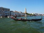 Wu Juan, a sampan rower from Zhouzhuang in China, joins a local Venetian gondolier in song.