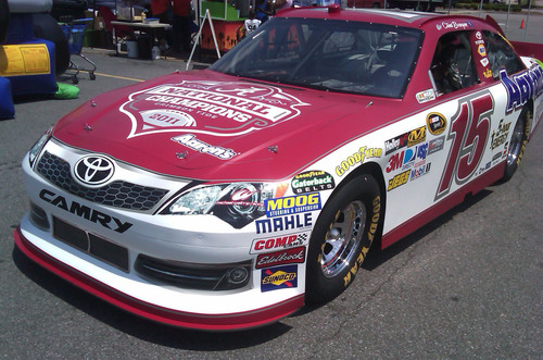 Aaron's, Inc. will honor BCS champion University of Alabama with a Crimson Tide-themed NASCAR paint scheme during the Aaron's 499 race at Talladega Superspeedway this weekend. The Michael Waltrip Racing No. 15 car will be driven on Sunday in the Sprint Cup series by Clint Bowyer.  (PRNewsFoto/Aaron's, Inc.)