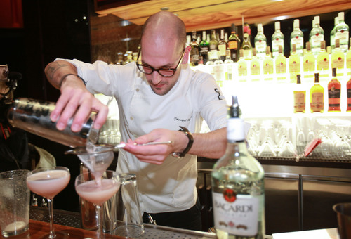 Milos Zica, winner of New York USBG Legacy Cocktail Showcase sponsored by BACARDI straining his innovative ...