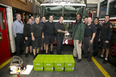 Queens Firefighters from Ladder 154, Engine 307 receive donated groceries from Peapod.