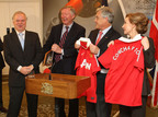 Vice chairman of Concha Y Toro wines Rafael Guilisasti (L) and Sir Alex Ferguson (2nd Left) of Manchester United present Chilean president Sebastian Pinera (2nd right) and his wife Cecilia Morel Montes (R) with a signed Manchester United shirt as a gift to the 33 miners recently rescued from the San Jose mine on October 17, 2010 in London, England.  (PRNewsFoto/Concha y Toro, John Peters/Man Utd via Getty Images)