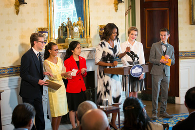 First Lady Michelle Obama hosts a poetry reading in honor of the 2014 National Student Poets (from left: Cameron Messinides, Madeleine LeCesne, Ashley Gong, Julia Falkner and Weston Clark) in the Blue Room of the White House, Sept. 18, 2014. (PRNewsFoto/Alliance for Young Artists...)
