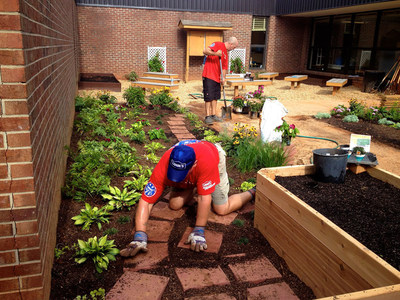 Lowe's Heroes employee volunteers create an outdoor learning space at Sope Creek Elementary School in Marietta, Ga.