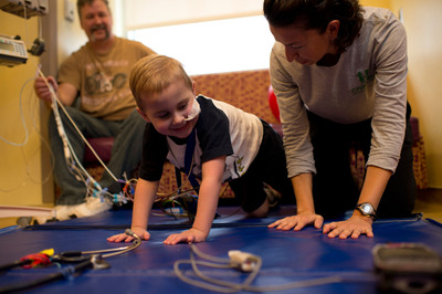 Lex Money, a patient at Children's Healthcare of Atlanta, participates in physical therapy after his heart transplant.