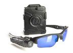 TASER International's AXON flex(TM) body-worn camera on Oakley(R) Flak Jacket Glasses. Photo courtesy of TASER, Scottsdale, AZ, USA.