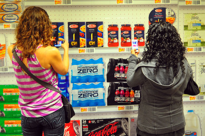 Peapod's virtual store program for commuter rail stations is a creative, convenient way for passengers to multi-task and knock out their grocery shopping on the go.  Smartphone users simply scan a QR code to download a free PeapodMobile app on the spot, and start shopping by scanning the bar codes of the products featured in the ads.  (PRNewsFoto/Peapod)