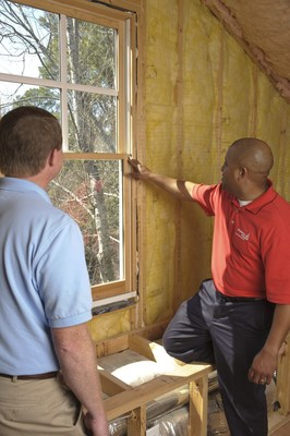 A Georgia Power representative discusses ways to save money and energy with a customer during an in-home energy audit. In-home energy audits are just one of the money-saving services available to customers as high temperatures increase use this week.