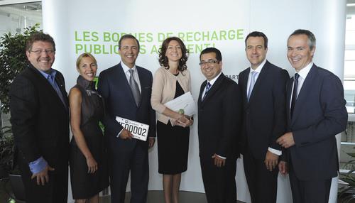 Joel Gauthier, President and CEO, AMT; Lyne Chayer, VP, Marketing, St-Hubert; Sam Hamad, Minister of Transport;  ...