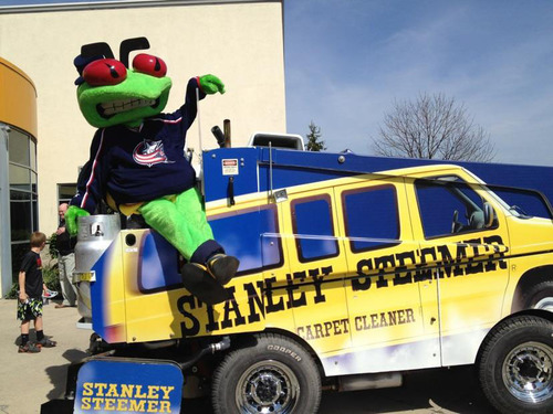 The Columbus Blue Jackets' mascot, Stinger, sits atop the Zamboni(R) ice resurfacing machine at Stanley ...