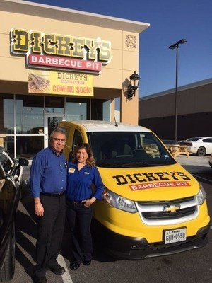 Owners/Operators Agustin Tellez, Jr and Isela Chamberlain in front of their Dickey's Barbecue Pit location at Military Crossing.