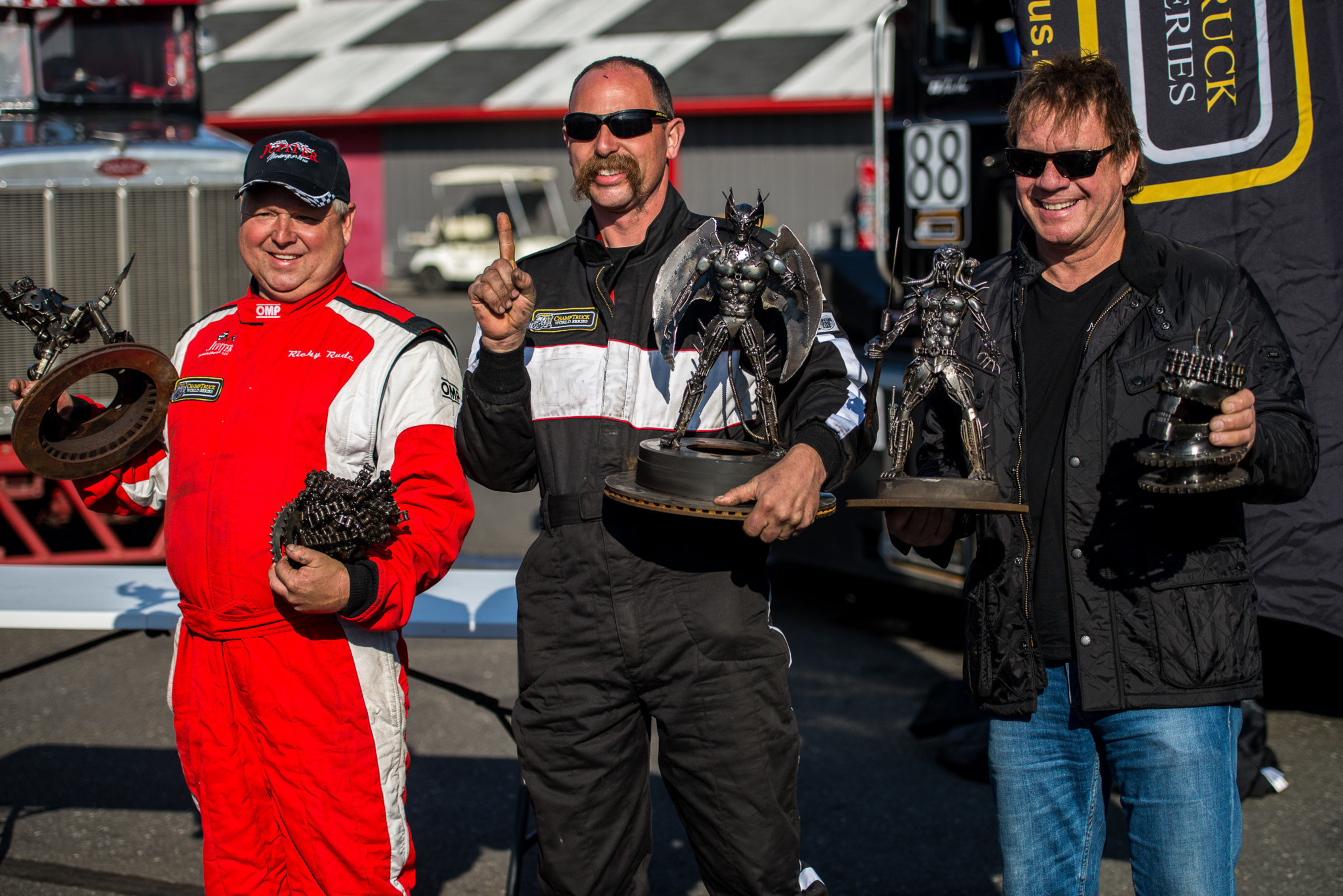 Mike Morgan (center) finished first in the inaugural Meritor ChampTruck World Series(R) at New Jersey Motorsports Park in Millville, New Jersey April 26. Ricky Proffitt Rude (left) came in second and Mike Ryan was third-place finisher.