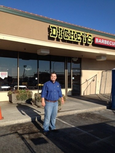 Dan Pelfrey outside his new Dickey's Barbecue Pit  in Kennewick. First location to the Tri-Cities opens ...