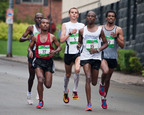 At mile 20, Eggleston catches Tariku Bokain (22), Isaac Birir (85), Teklu Deneka (23) and David Rutoh, before surging ahead to victory.  (PRNewsFoto/Dick's Sporting Goods Pittsburgh Marathon, Abby Kraftowitz)