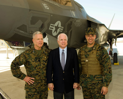 From the left, Commandant of the Marine Corps General James F. Amos, U.S. Senator John McCain (AZ) and Marine Fighter Attack Squadron 121 Commanding Officer Lt. Col. Jeffrey Scott stand near an F-35B at Marine Corps Air Station Yuma, Ariz. after the squadron's re-designation ceremony Nov. 20.  (PRNewsFoto/Lockheed Martin Aeronautics Company)