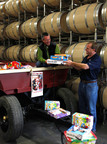 Tim Spence, director of operations (left), and John Jordan, CEO of Jordan Winery, load the Alexander Valley gondola with Toys for Tots donations.  (PRNewsFoto/Jordan Vineyard & Winery)