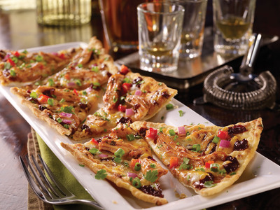 Nine new craveable dishes featuring bold new flavor combinations, like the crispy BBQ Chicken Flatbread appetizer combining a smoky chipotle barbecue sauce with juicy pulled chicken, give Friday's guests exciting options to celebrate that Always Friday feeling. (PRNewsFoto/T.G.I. Friday's)