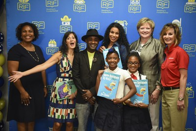 From left, Principal TaMikka Sykes, children's author Tara Lazar, actor/musician Tray Chaney, singer/actress Jordin Sparks, RIF President and CEO Alicia Levi, State Farm Senior Vice President and RIF Board Member Christy Moberly along with two students from Amidon-Bowen Elementary School celebrate Reading Is Fundamental's 50th Anniversary on Wednesday, Sept. 14, 2016, in Washington. (Kevin Wolf/AP Images for Reading Is Fundamental)