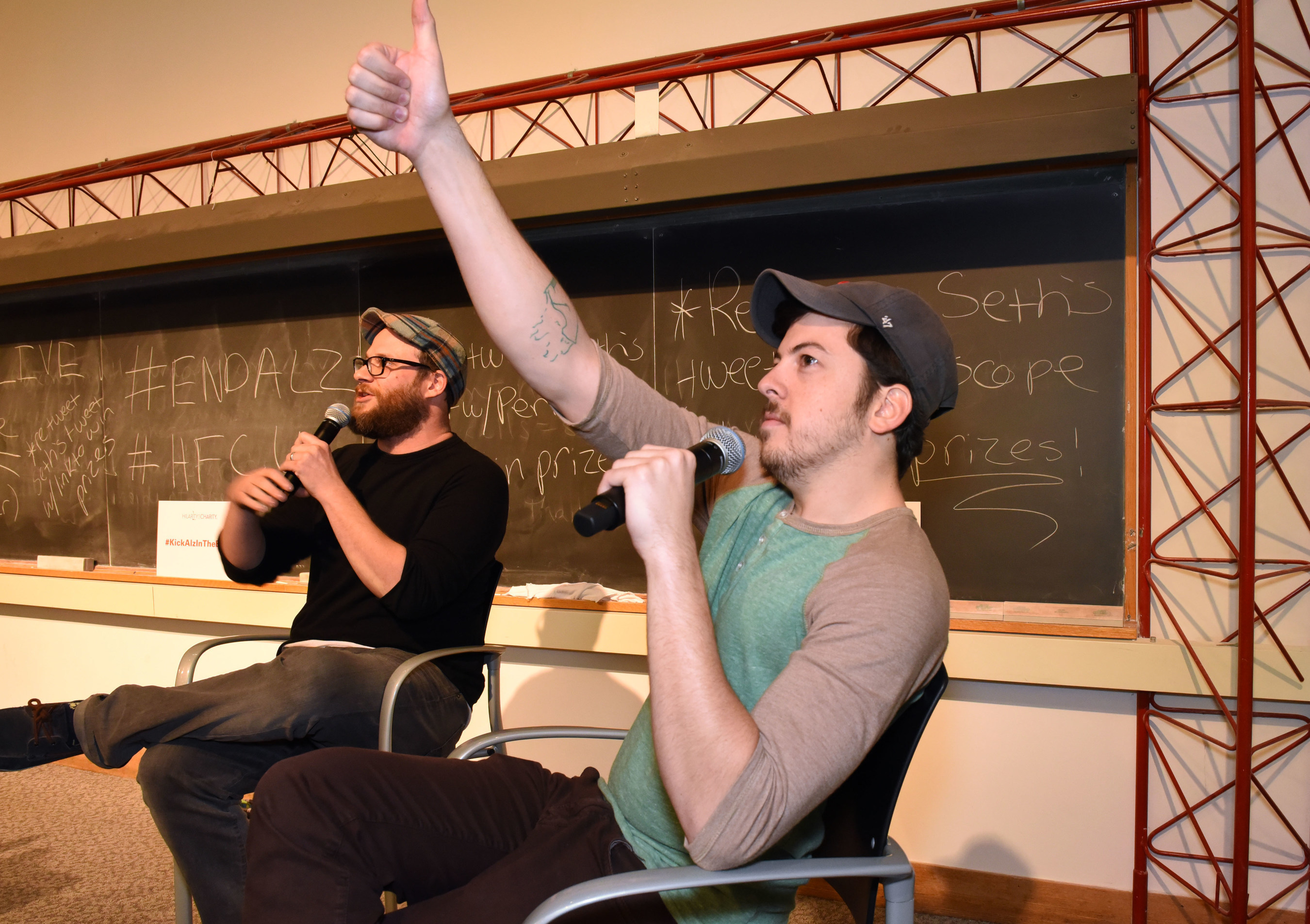 Actors Seth Rogen and Chris Mintz-Plasse provide live commentary during a special screening of their movie Superbad with this year's winners of Hilarity For Charity U - Pi Kappa Alpha fraternity and Alpha Chi Omega sorority at the University of Vermont on Saturday, April 25, 2015 in Burlington, Vt. UVM's Pi Kappa Alpha fraternity and Alpha Chi Omega sorority this year raised more than $30,000.00 for Hilarity for Charity U, benefiting the Alzheimer's Association. For more information please visit http://www.hilarityforcharity.org. (ALISON REDLICH/AP Images for Hilarity For Charity U)