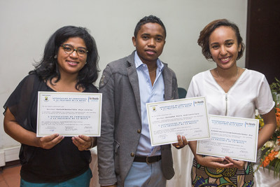 Three of HelpMeSee's first surgeon partners show off their MSICS training certificates during a graduation ceremony in Antananarivo, Madagascar.