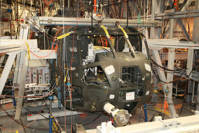 The CH-53K Static Test Article has successfully completed required pre-flight test conditions at Sikorsky's Stratford, Conn. facility to substantiate airframe strength for first flight of the CH-53K heavy lift helicopter in late 2014. The tests are part of a three-year program to validate that the largest helicopter ever designed and built by Sikorsky has the structural integrity to operate safely over its entire flight envelope - from its empty gross weight of 44,000 pounds up to its maximum gross weight of 88,000 pounds with external load.  (PRNewsFoto/Sikorsky Aircraft Corp.)