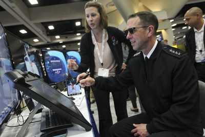 Heidi Buck, left, an engineer at the Space and Naval Warfare Systems Center Pacific (SPAWAR), shows CNO Adm. John Richardson a 3-D training environment on display at the Navy Information Warfare booth during WEST 2016. Adm. Richardson participated in a town hall luncheon at the event to wrap up a three-day visit to San Diego. The Armed Forces Communications and Electronics Association (AFCEA) and U.S. Naval Institute (USNI) cosponsor the a three-day conference. (U.S. Navy photo by Greg Vojtko/Released)