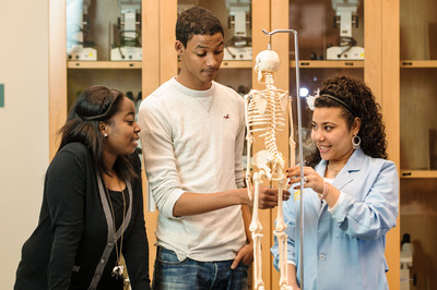 Xavier University of Louisiana students rank top among STEM discipline graduates.  Three students participate in a lab study group on the New Orleans campus.  (PRNewsFoto/Xavier University of Louisiana)