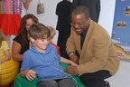 "LeVar Burton and 7 year old Shane Ammon exploring the all Reading Rainbow adventure app at the ""Reading Rainbow Relaunch"" event, June 19, 2012 New York.  (PRNewsFoto/Reading Rainbow)"