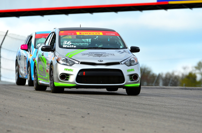 Kinetic Motorsports Captures First Win in Forte Koups at Canadian Tire Motorsports Park. (PRNewsFoto/Kia Motors America)