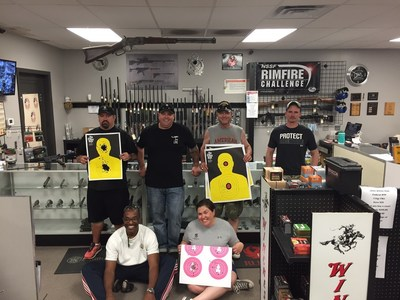 Warriors show off their targets after a day at the firing range in Ottawa, Kansas.